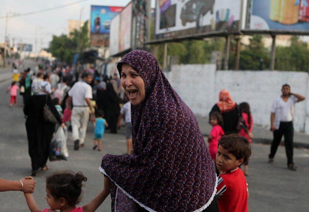 Family running away in Gaza